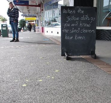 A Kaikohe retailer's protest involves painting blobs of chewing gum yellow.
