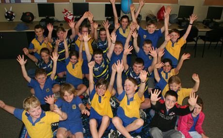 TIME TO CELEBRATE: Wowan State School students celebrate the opening of their new classroom.