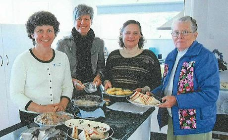 ALL SMILES: Members of the Condamine Arubial Country Women's Association branch in their new kitchen are Alison Topp, Helen Clarke, Sharon Tilly and Amy Dunn.