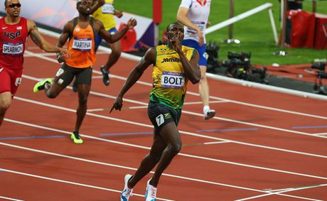 Usain Bolt of Jamaica races to the finish line to win gold ahead of Warren Weir of Jamaica in the Men&#39;s 200m Final on Day 13 of the London 2012 Olympic Games at Olympic Stadium on August 9, 2012 in London, England.  