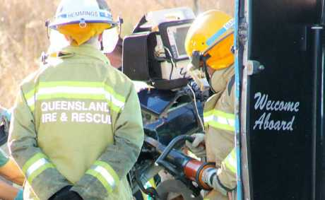 Queensland Fire and Rescue Service crews at the accident scene on Wednesday.