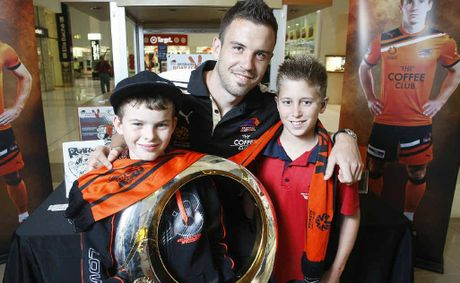 Mitchell Buchanan and Joshua Doyle with Brisbane Roar player Matt Jurman at the Coffee Club at Riverlink.