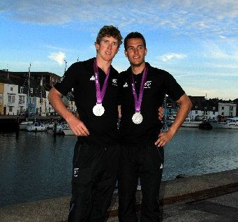 LONG WAIT: Blair Tuke and Peter Burling with their medals, Northland's first in 16 years.
