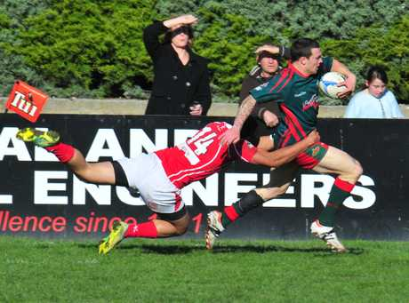 Dual try scorer Wairarapa-Bush winger Nathan Hunt attempts to evade the tackle of Poverty Bay's Caleb West.