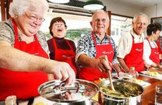 Greg Ford (centre) with the rest of his group enjoying the 100th cooking lesson at Jamie's ministry of Food in Ipswich.