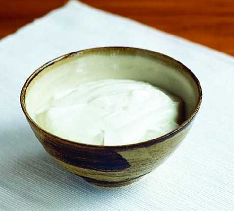 Home made yoghurt can be made thicker if you boil it to reduce the volume.