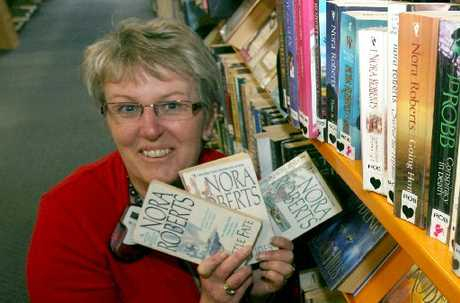 OH NORA: Masterton Library manager Sandy Green with a few of the books by prolific author Nora Roberts, some of the most popular issues at the library. PHOTO/LYNDA FERINGA