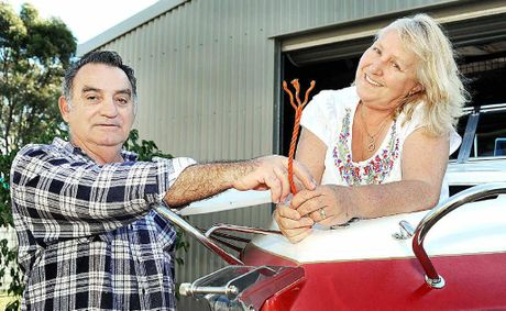 Wally and Penny Marz from Urangan with the anchor rope they had to cut after it was hooked by a whale while they were out fishing.