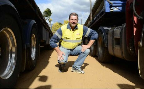 EX-IRONMAN: Christopher Blanchard next to his trucks at the Grafton Blanchards depot.