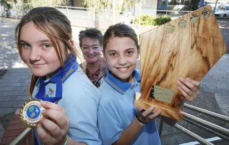 Bilambil students Kiarah Young, Chloe Baker and Heather Martin are celebrating their choir win.