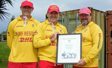 TOP CLUB: Pictured with the State surf life saving club award are (from left) Ballina Lighthouse and Lismore SLSC captain Andrew Dougherty, president Kris Beavis and chief training officer Rod Balkin at Shelly Beach.