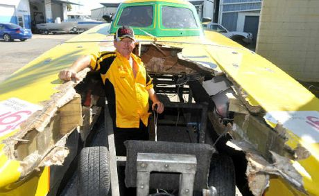 Scott Gehrman surveys the wreckage of superboats competitor BBC Digital after it crashed at speed at Mooloolaba.