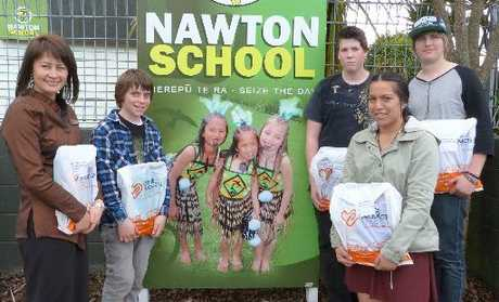 Nawton Primary principal Rubina Wheeler (far left) accepts stationery packs donated by Waikato Office Products Depot and organised by Project K students, from left, Frank Cronin, Liam Atkinson, Stacey Beazley and Matthew Bennett.