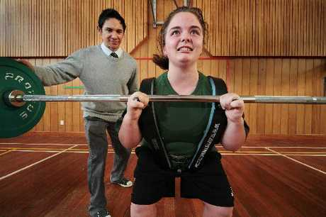 Chinayd O'Sullivan, year 10 Karamu High student weightlifter with her PE Health teacher Aron Noble who helped Chinayd to set a record breaking lift in the school gym on the 3 August 2012. Photograph Warren Buckland