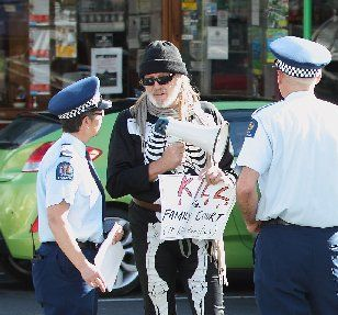 DAD'S RIGHTS: Police talk to fathers' rights protester Kerry Bavin outside the Rotorua Family Court yesterday.