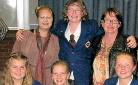 The victorious Warwick State High School Year 8 debating team (back, from left) coach Sarah Pavitt, Dana Jamieson, debating co-ordinator Judy Hefferan, (front) Sarah Pickering, Emily Follett and Aleisha Hamilton.