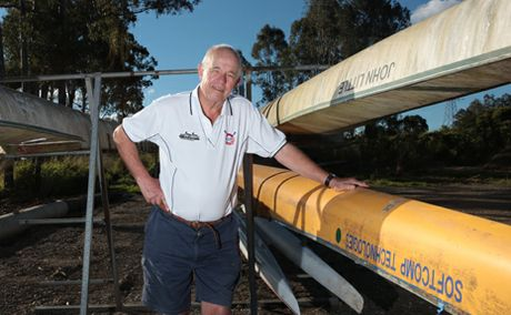 LOST AND FOUND: Simon Newcomb from Centenary Rowing Club are looking for anyone who may have any information about a boat found in the Brisbane River. Photo: Inga Williams / The Satellite
