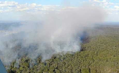 A fire burns out of control in inaccessible terrain in the Clarence Valley.