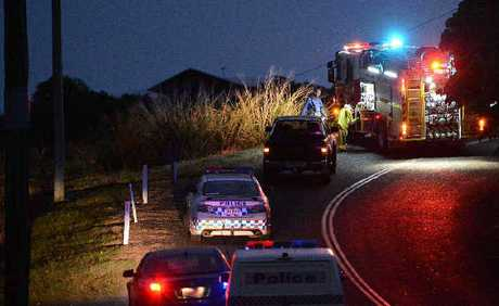 Emergency service crews at the scene of the fatal accident on Ian Reddacliff Drive at The Leap last night.