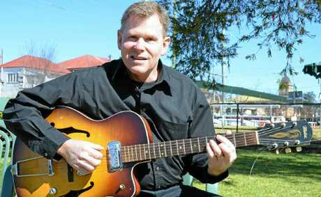 Andrew Carines holds his late uncles guitar at the Vietnam Veterans Day service at the weekend.