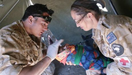 A file photo of New Zealand medics Lance Corporal Luke Tamatea (Royal New Zealand Infantry Regiment) and Sergeant Jo Walters (Royal New Zealand Airforce) treat a baby in Afghanistan.