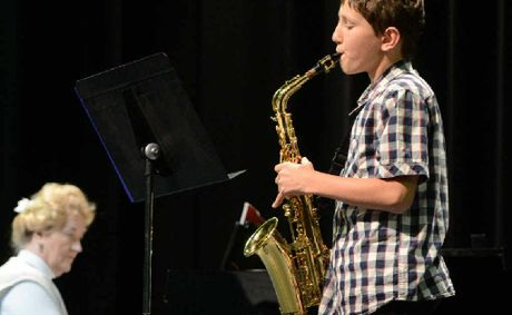 Jonathon Easton places third in the 11–12 years woodwind solo, saxophone section.