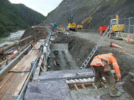 ON TARGET: Manawatu Gorge work crews are on target to have a single lane open to traffic by the end of August and two lanes open late next month.