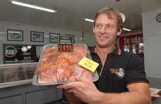 Mackay butcher Rod Den Elzen proudly displays his marinated lamb chops.