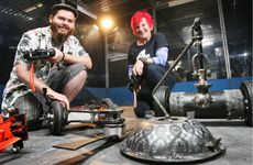 Miles Blow and Jules Pitts show off their robots to be used in the national Robowars competition. 