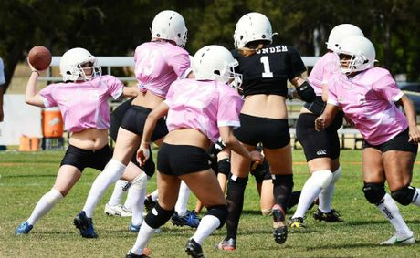 Ladies Football League gridiron action between Brisbane (black) and Logan (pink) at Brother Seery Park.