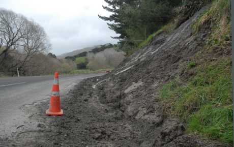 COMMON SIGHT: Slips like this one on Masterton's Castlepoint Rd, a result of storm damage, have plagued Wairarapa this winter.