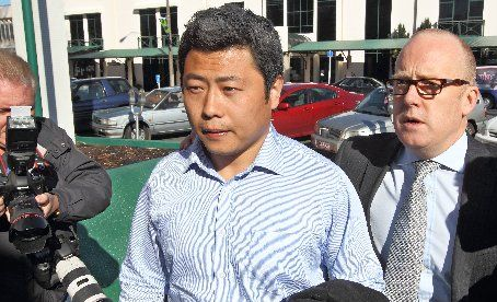 "OUTSIDE COURT: Hui ""Leo"" Gao arrives at the Rotorua Courthouse with his lawyer Ron Mansfield."