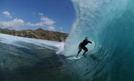 Nick Heath surfing stand-up barrels in Indonesia.