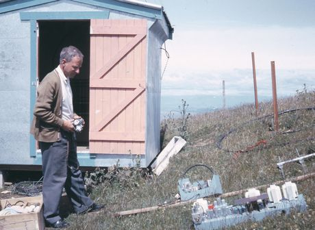 Ivan Small at the rather basic television translator site on Kahuranaki in late 1962 - the translator equipment is spread on the ground awaiting installation.