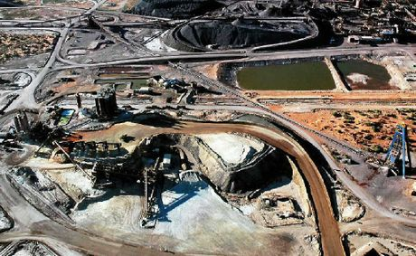 Expansion of BHP's Olympic Dam mine in South Australia has been put on the backburner. Meanwhile, billions of dollars worth of energy projects in the Surat Basin are forging ahead.