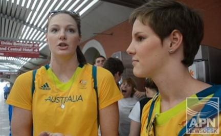 Cate (left) and Bronte Campbell at the welcoming home parade for Queensland's Olympians on Friday.