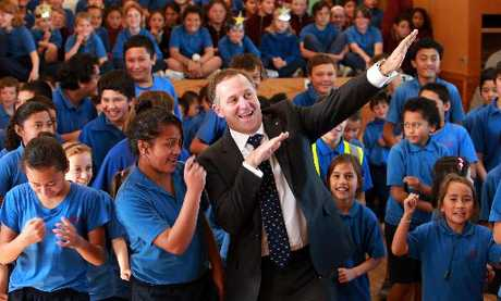 John Key joins Nuhaka School pupils to dance to Beyonce during a visit to the Wairoa region yesterday.
