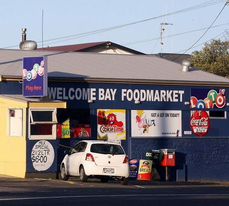 Two men armed with pistols robbed the Welcome Bay Foodmarket.