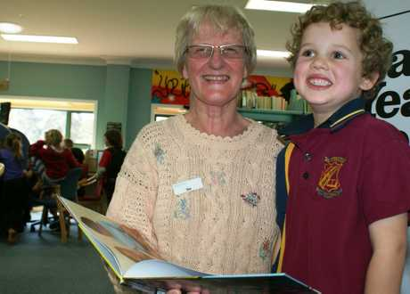 Maleny library coordinator Sue McCleary having a read with local resident Carter Ruhle