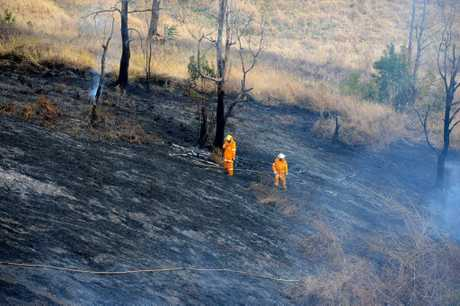RURAL fire crews have extinguished a grass fire which threatened several homes at Obi Obi on Monday Photo:Warren Lynam / Sunshine Coast Daily