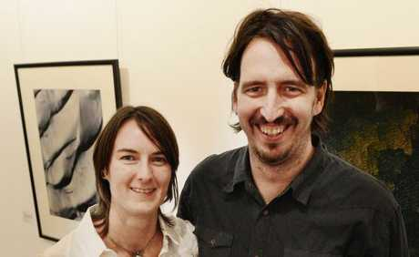 Artist Greg Harm at his gallery opening with his wife Emma on Friday night.