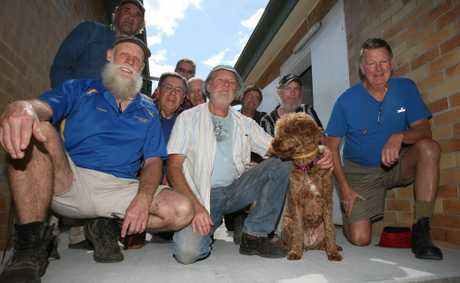 Murwillumbah Men&#39;s Shed members admire the new concrete slab they are working on.