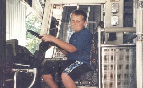Ten-year-old Jamie getting in some early practice behind the wheel of an Austens bus.