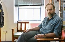 Charismatic actor Hugo Weaving takes a break during filming at the former Ipswich police station in the city CBD. Weaving plays a police detective in talented young Australian writer and director Ivan Sens taut thriller Mystery Road.