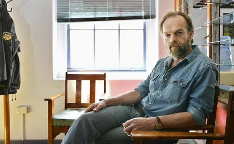 Charismatic actor Hugo Weaving takes a break during filming at the former Ipswich police station in the city CBD. Weaving plays a police detective in talented young Australian writer and director Ivan Sen's taut thriller Mystery Road.