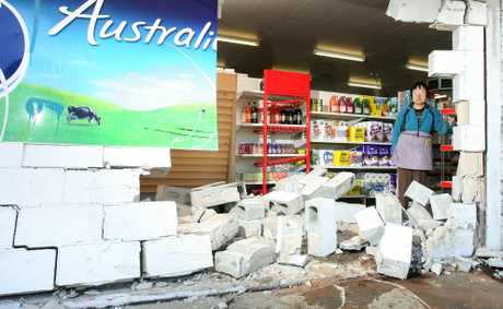 Warwick Road Four Square store owner Bing Liu inspects the damage caused to her shop after a vehicle lost control and smached through the wall early on Saturday morning. Photo: Rob Williams / The Queensland Times