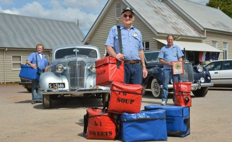 Meals on Wheels deliveries came in a variety of antique cars yesterday, including the 1937 Chevrolet owned by Brien Fazel (front).