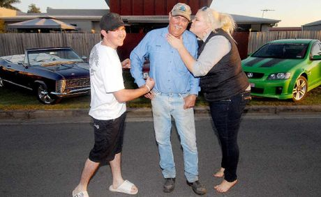 Wayne Shannon with his children, Clinton and Madalyn, love their cars – a 1965 Buick Riviera and 2007 VE SS ute. Wayne's car, a 1978 HZ Ute (centre), is obscured.