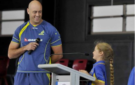 Mater Dei student Catherine Hodal asks her special school guest Nathan Sharpe about some of his memorable Wallaby career moments.