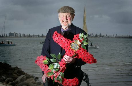 REMEMBRANCE: Captain Bob Wyld, who served in the Merchant Navy as a teenager, holding the wreath that was laid in memory of the Merchant Navy personnel who died during World War II.